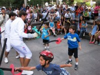 Getting kids active at a fencing demonstration.