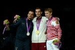 Diego Occhiuzzi (ITA), Aron Szilagyi (HUN), and Nikolay Kovalev (RUS) on the medal stand.