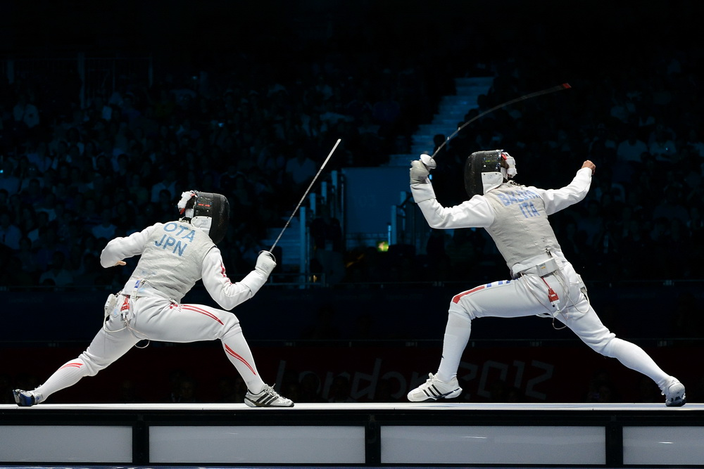 Yuki Ota and Andrea Baldini fight for the Gold Medal.  Photo Craig Harkins/Fencing.Net