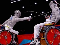 Chen Yijun (CHN) and Tian Jianquan (CHN) compete in the men's Individual Sabre Wheelchair Fencing - Category A final on Day 8 of the London 2012 Paralympic Games at ExCeL.